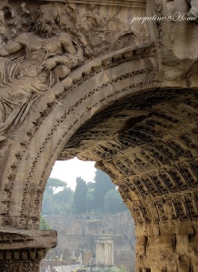 The ruins of Rome through the Arch of Constantine